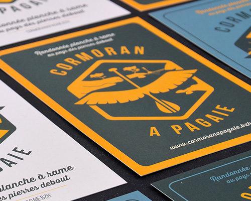 Logo Cormoran à Pagaie - Com un poisson - Graphiste Bretagne